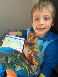 Braiden with his LAMP Words for Life app asking for a book